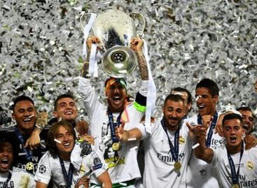 Real Madrid lift Champions League trophy after penalties